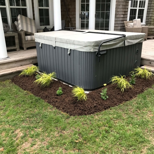 Plant bed around above ground Jacuzzi