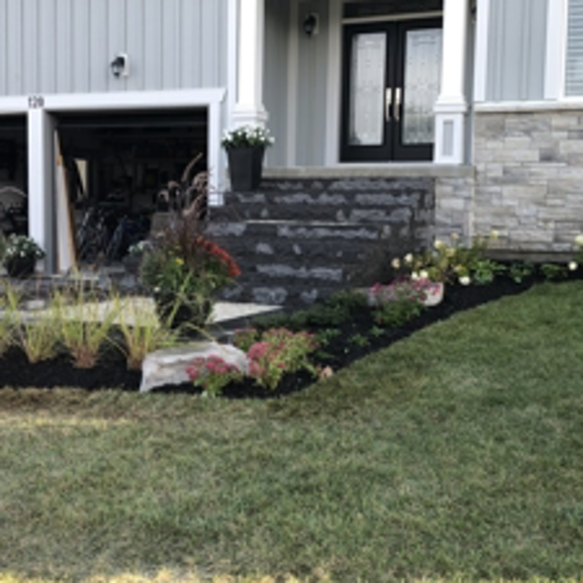 Banas natural stone steps, new sod and hydro seed of the remaining lots.